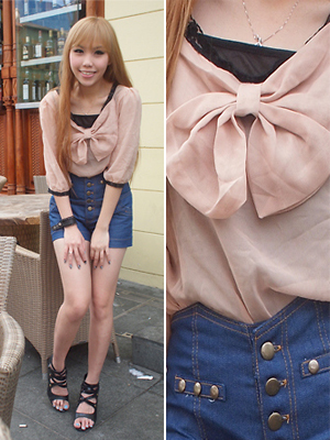 light pink silk blouse with bow and high waisted denim shorts valentine's day outfit