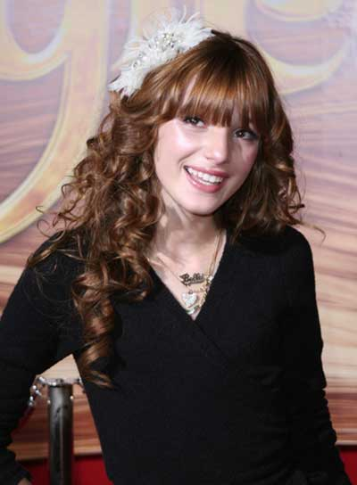 Bella Thorne Long, Romantic, Curly, Red Hairstyle with Bangs