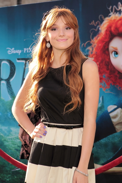 Bella Thorne's Long, Red, Wavy Hairstyle with Bangs