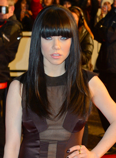 Carly Rae Jepsen's Long, Black, Straight Hairstyle with Bangs