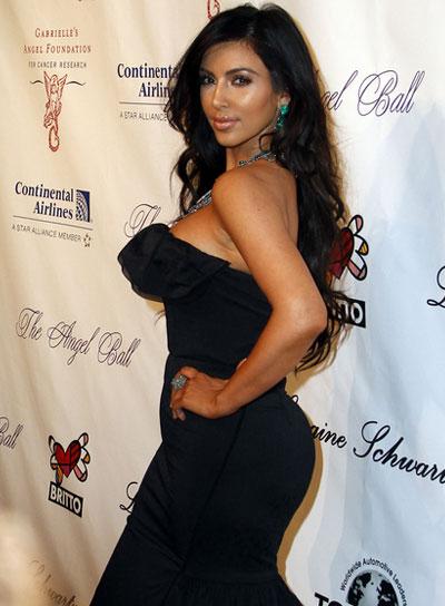 Kim Kardashian Curly, Tousled, Brunette Hairstyle