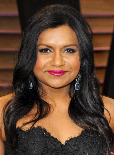 Mindy Kaling with a Long, Black, Sophisticated, Wavy Hairstyle
