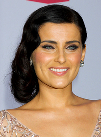 Nelly Furtado's Medium, Romantic, Black, Wavy Hairstyle
