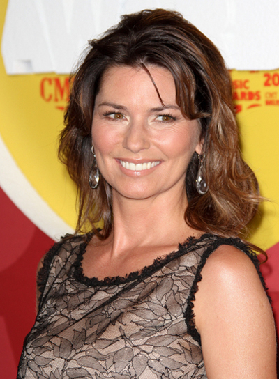 Shania Twain Long, Tousled, Layered, Brunette Hairstyle with Bangs
