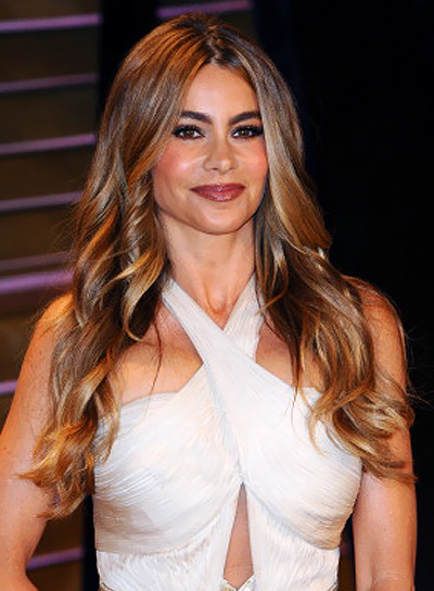 Sofia Vergara with a Long, Wavy, Brunette Hairstyle with Highlights