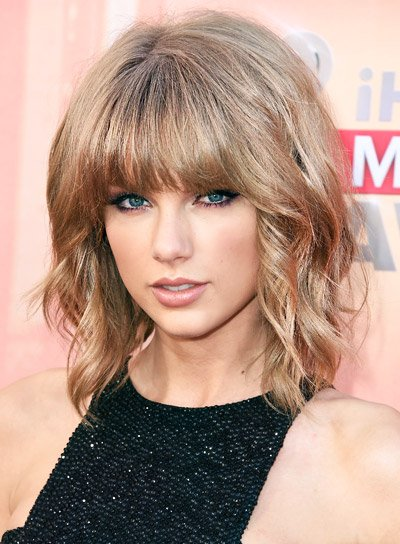 Taylor Swift with a Short, Wavy, Blonde, Bob Hairstyle