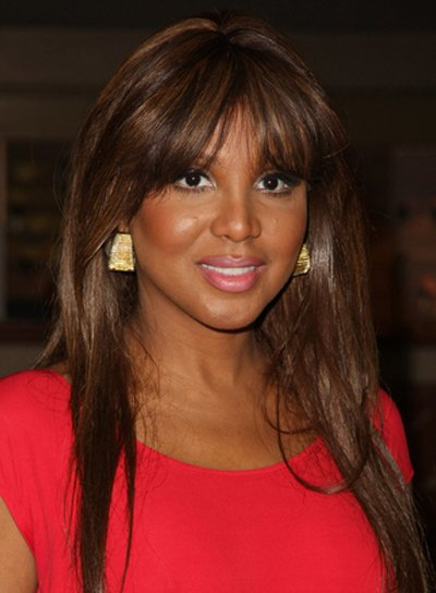 Toni Braxton Long, Straight, Chic, Sophisticated, Black Hairstyle with Bangs and Highlights