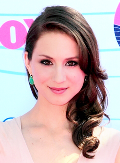 Troian Bellisario's Medium, Romantic, Curly, Brunette Hairstyle